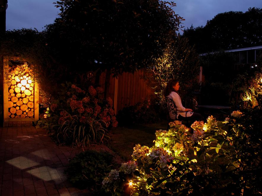 Stoneleigh Warm White LED Spotlights illuminating a small garden